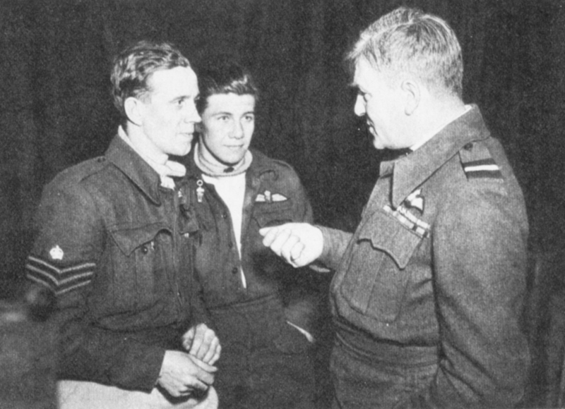 Air Commodore Arthur Wray talking to Douglas Sutton and his navigator