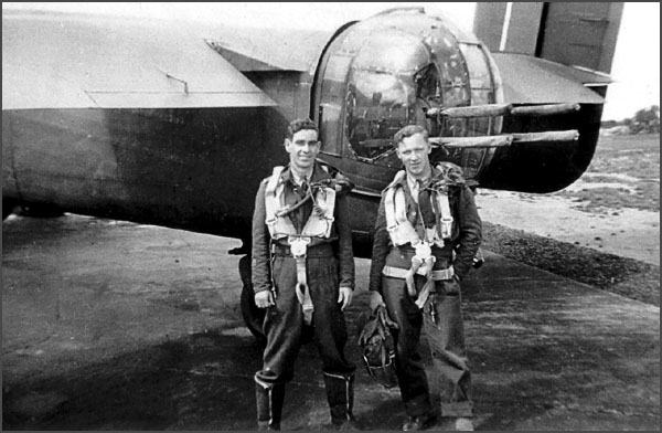 Harold Edwards and Rolland Wallace by the rear turret of BM-B 'Beer Is Best'.